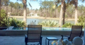 15 Pondhawk Rd Oldfied View patio and pool over looking pond in back